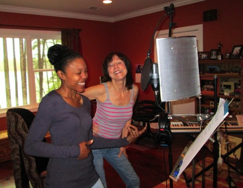 "Dana Rice and Jayne recording background tracks. Dana on ""air guitar""!"